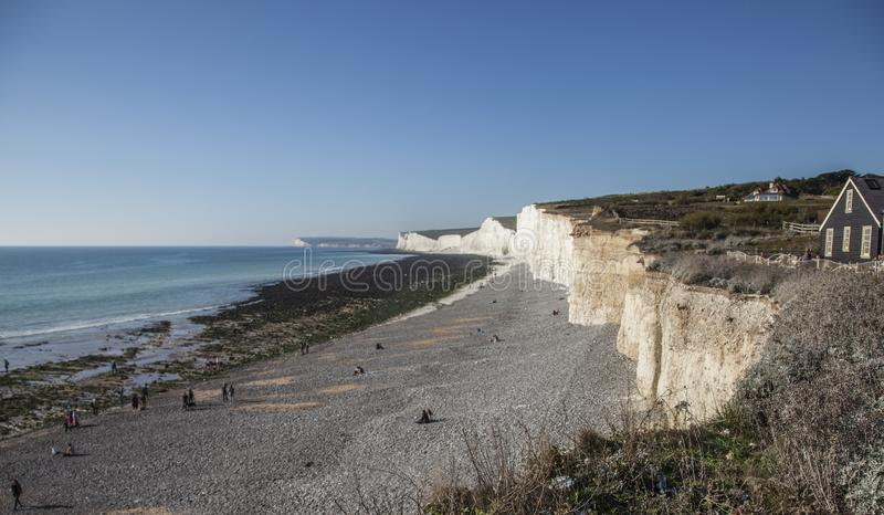 Seven Sisters cliffs, East Sussex - seas, skies and meadows. This image shows a view of Seven Sisters cliffs in East Sussex, England, the UK. It was taken on a royalty free stock photography