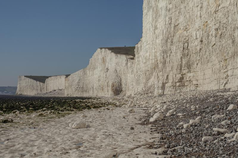 Seven Sisters, East Sussex, England, the UK; white beach and blue skies. . This image shows a view of Seven Sisters, East Sussex, England, the UK - cliffs and royalty free stock photography