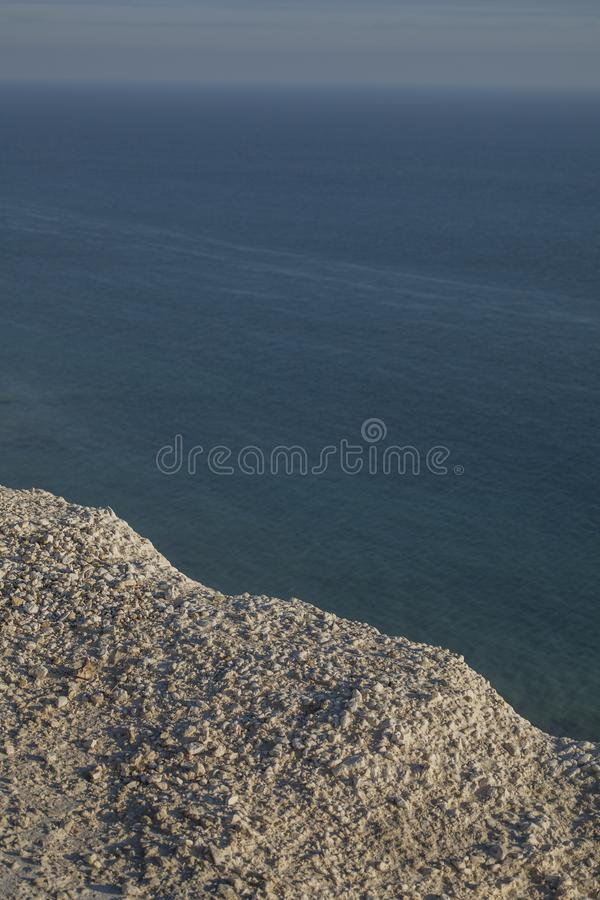 Seven Sisters, England - white cliffs, blue waters and seas. This image shows some white cliffs in Seven Sisters, Eastbourne, England, the UK. It was taken on a stock photos