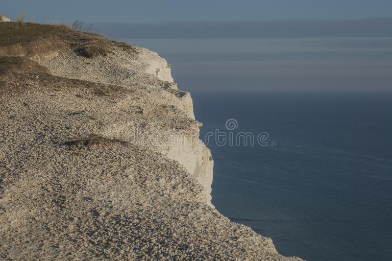 Seven Sisters - white cliffs, blue waters and seas. This image shows some white cliffs in Seven Sisters, Eastbourne, England. It was taken on a great, bright stock photography