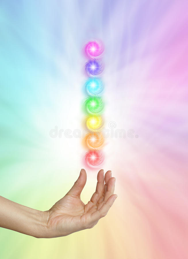 Seven Spinning Chakras on Rainbow colored background stock photos
