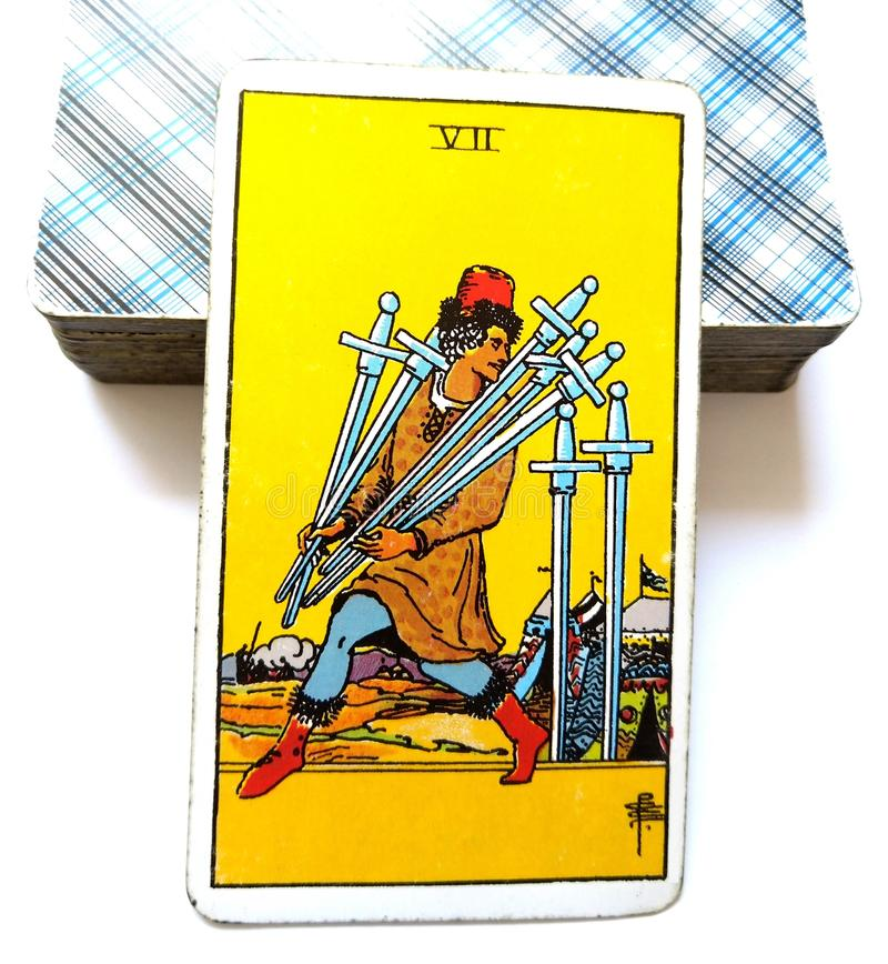 7 Seven of Swords Tarot Card Logic Reason Ahead of the Posse Adaptability Flexibility Plotting & Planning Strategies stock photography