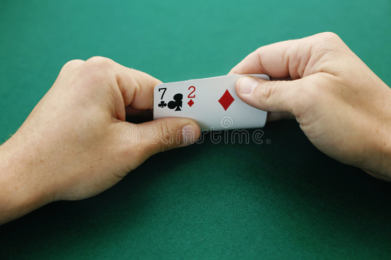 Seven two off-suit stock photography
