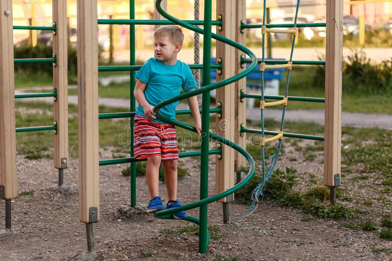 Seven-year-old sports boy in shorts playing in the summer on the Playground royalty free stock photos