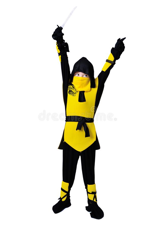 The seven-years old boy in black and yellow ninja suit with a ho stock photo