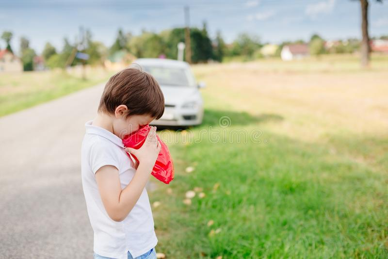 Seven years old child suffers from motion sickness. Seven years old child feeling bad - suffers from motion sickness stock photo