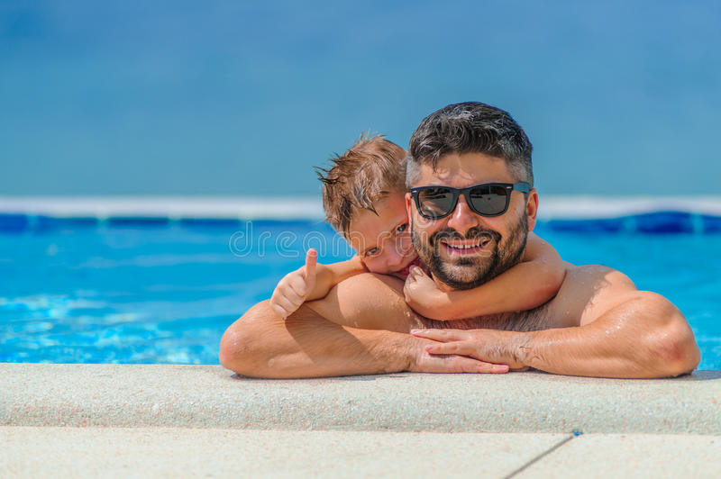 Seven years old cute boy smiling without tooth. He and his beard stock photos