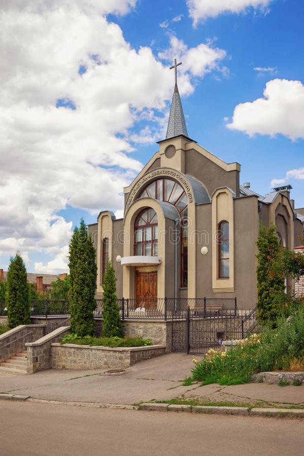 Seventh-day Adventist Church. Uman town, Ukraine. Ukrainian text means: `Christian Church of seventh-day Adventists` and over the door `Peace be with You stock photography