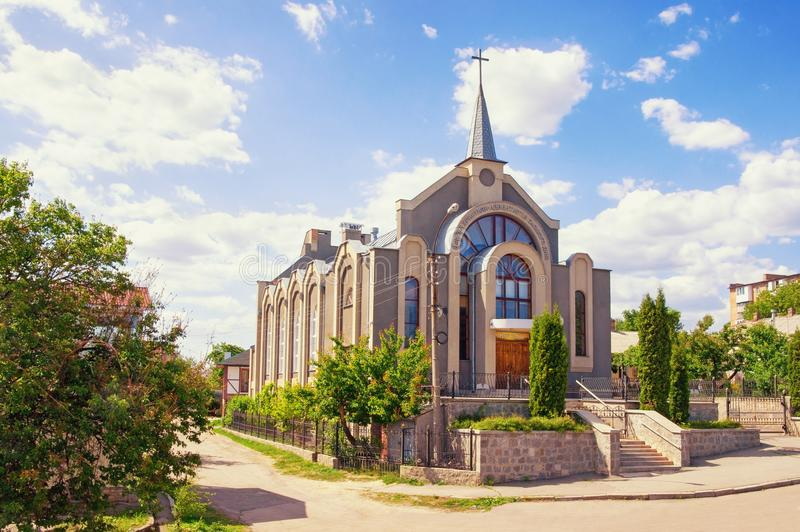 Seventh-day Adventist Church in Uman town, Ukraine. Ukrainian text means: `Christian Church of seventh-day Adventists` and over the door `Peace be with You royalty free stock photography