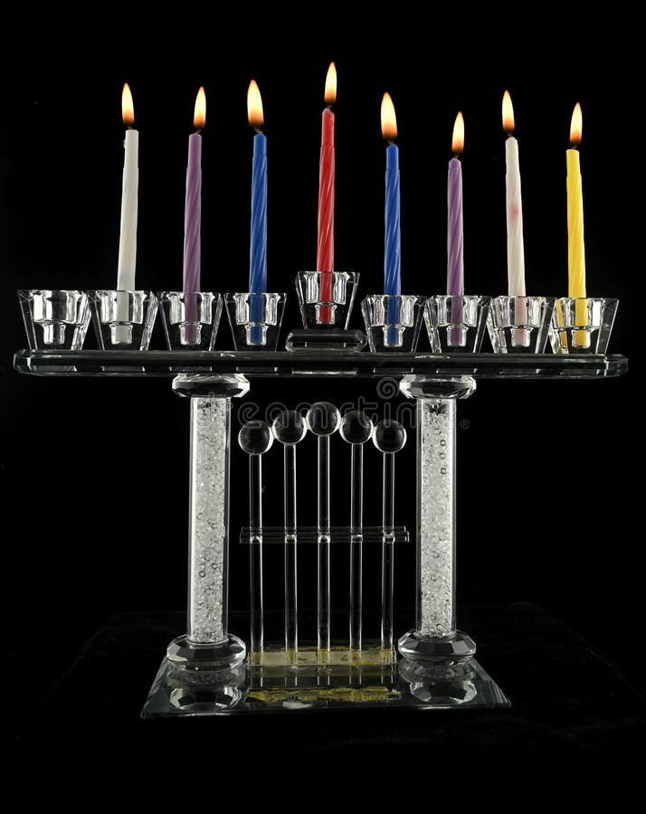 The seventh day Hanukkah menorah crystal lamp. That is lit for eight days of Hanukkah on a black background stock image