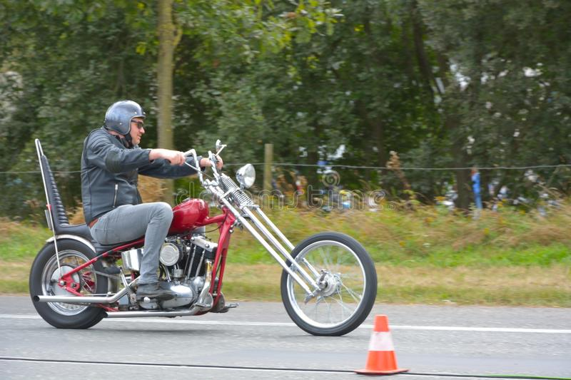 Seventies cycle run event , 70's Bikers. GHENT, BELGIUM, SEPTEMBER 2016: Start grid:Seventies cycle run event , several seventies motor cycling Bikers ready to stock photography