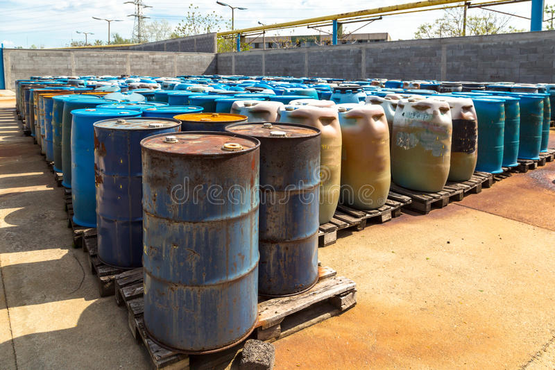 Several barrels of toxic. Waste at the dump stock images