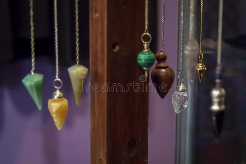 Several Beautiful Crystal Pendulums Hanging on Display stock photography