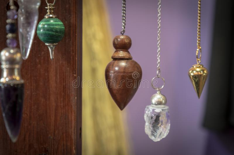 Several Beautiful Crystal Pendulums Hanging on Display royalty free stock images
