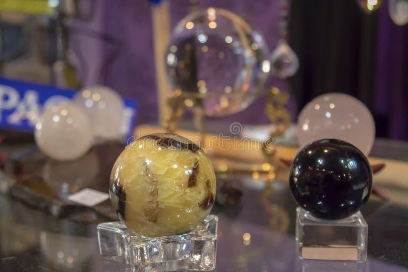 Several Beautiful Healing Crystal Balls on Display stock image