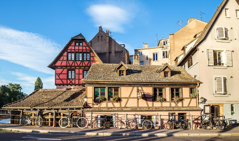 Several bicycles are located along the old houses in Strasbourg, France royalty free stock photos