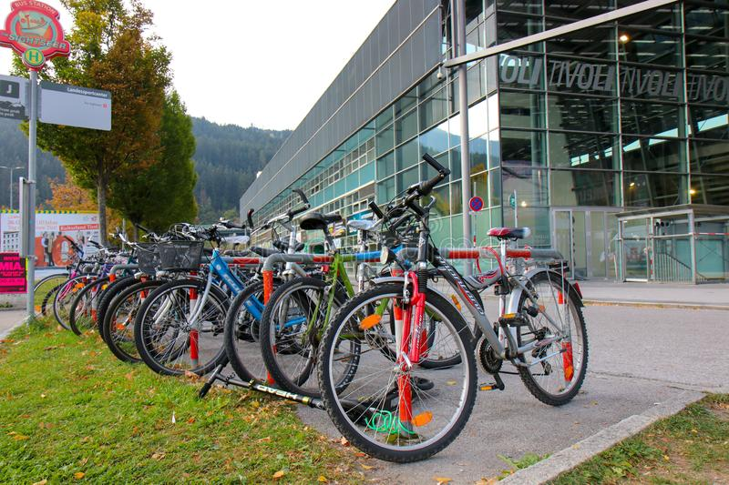 Several bicycles in a row for sharing system in Innsbruck, Austria. Innsbruck, Austria - Oct 18, 2018: Several bicycles in a row for sharing system in Innsbruck royalty free stock image