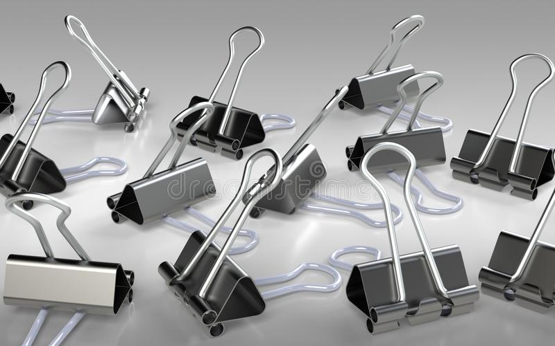Several binder clips placed on the grey background stock illustration