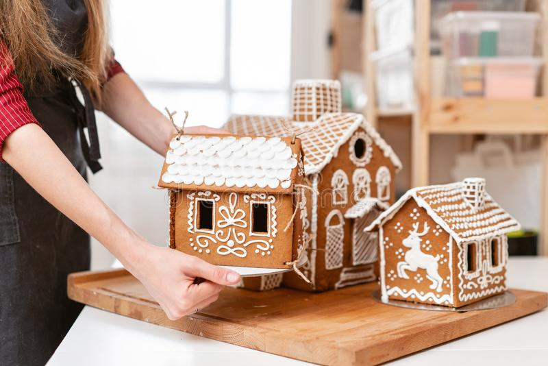 A several of biscuit gingerbread houses . Decorated with white sweet glaze. Christmas mood, winter morning. A young stock photo