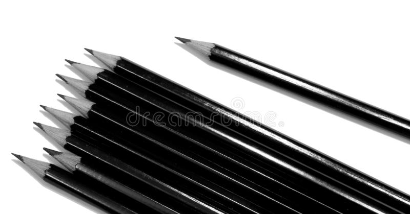 Several black drawing pencils isolated on white royalty free stock photo