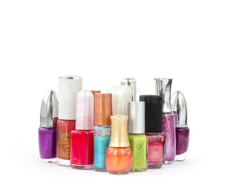 Several bottles of nail polish. Several colorful bottles of nail polish on white background stock photography