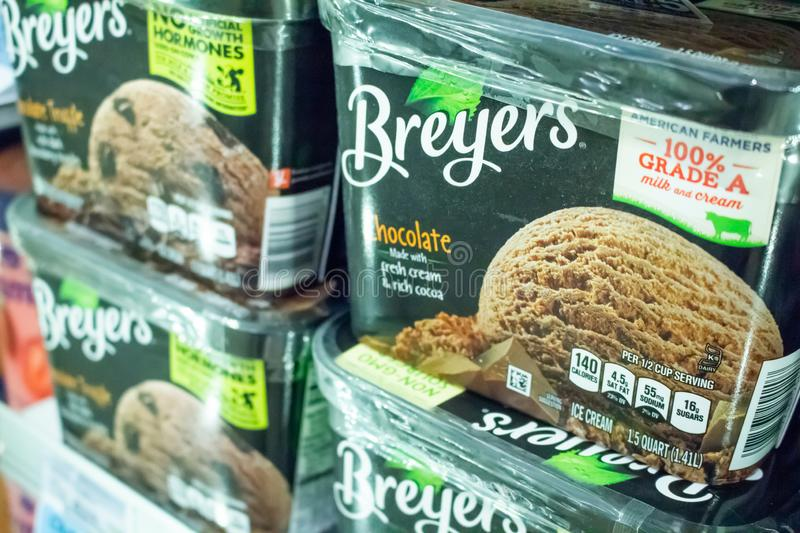 Breyers Ice Cream at the store. Several Breyers ice cream containers in the freezer section of a local grocery store stock photo