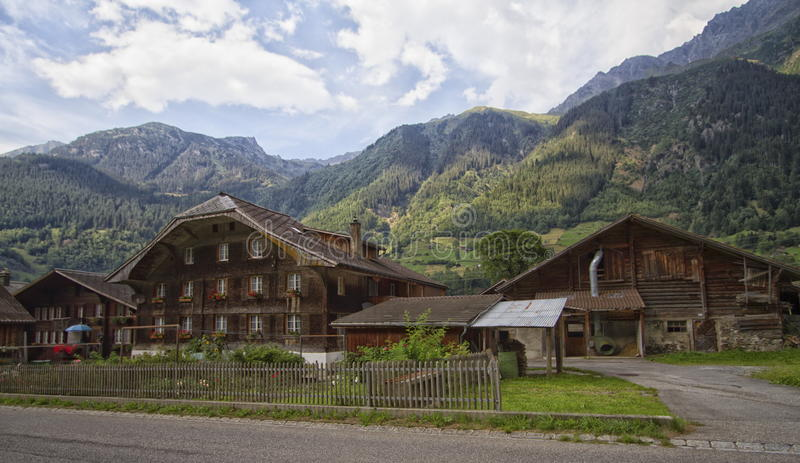 Several chalets in Swiss mountain. Several chalets and trees in Swiss mountain royalty free stock image
