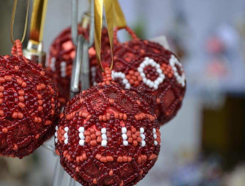 Several Christmas balls of red and white beads. royalty free stock photo