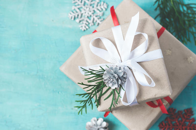 Several Christmas boxes of gifts festively decorated On a turquoise background, selective focus royalty free stock image