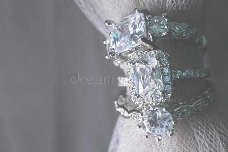 Several diamond wedding engagement rings. Fine jewelry. Several diamond wedding engagement rings on a wedding day. Fore engagement. Fine jewelry stock photography
