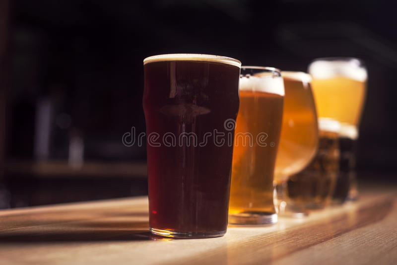Several different beers are standing in a row stock photos