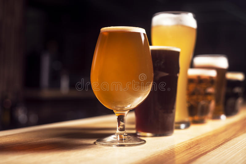 Several different beers are standing in a row stock photography