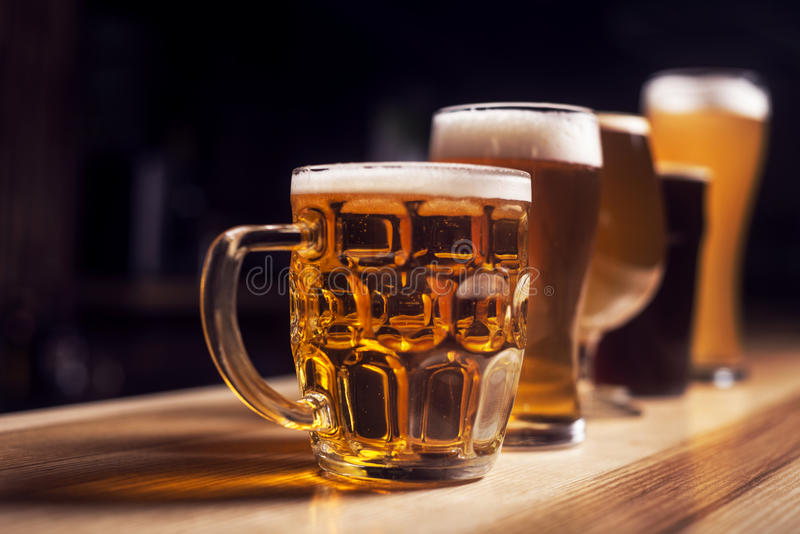 Several different beers are standing in a row royalty free stock image