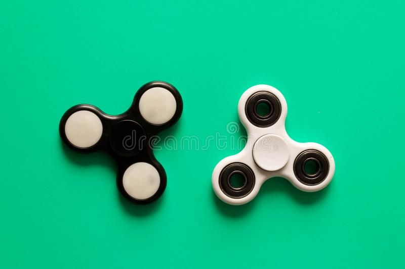 Several different fidget spinners . Isolated on blue background stock photography