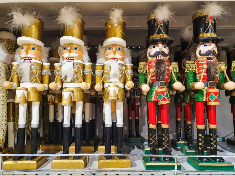 Several different nutcraker soldiers toys displayed in a store, christmas decoration for sale in market Happy New Year royalty free stock images