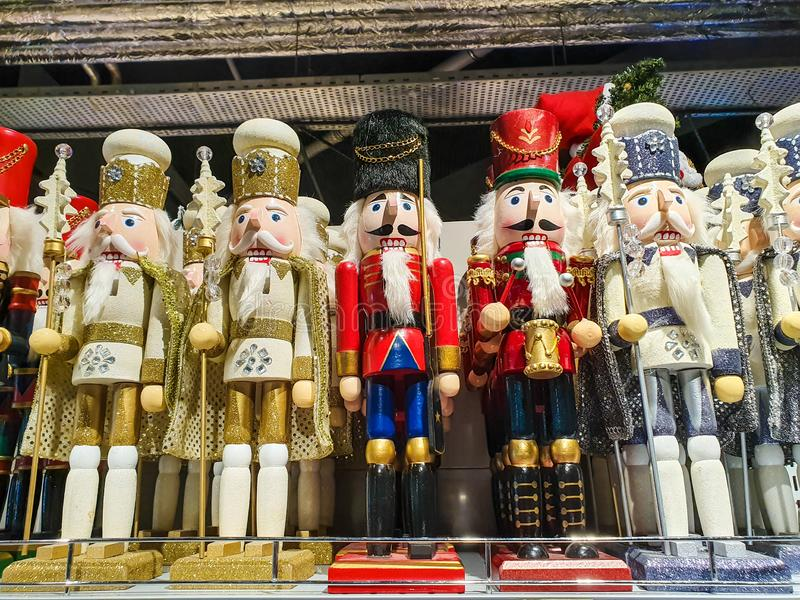 Several different nutcraker soldiers toys displayed in a store, christmas decoration for sale in market Happy New Year stock photography
