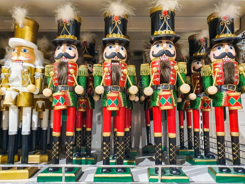 Several different nutcraker soldiers toys displayed in a store, christmas decoration for sale in market Happy New Year stock image