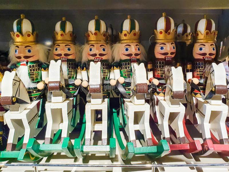Several different nutcraker soldiers toys displayed in a store, christmas decoration for sale in market Happy New Year stock photos