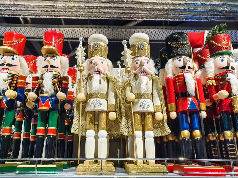 Several different nutcraker soldiers toys displayed in a store, christmas decoration for sale in market Happy New Year stock images