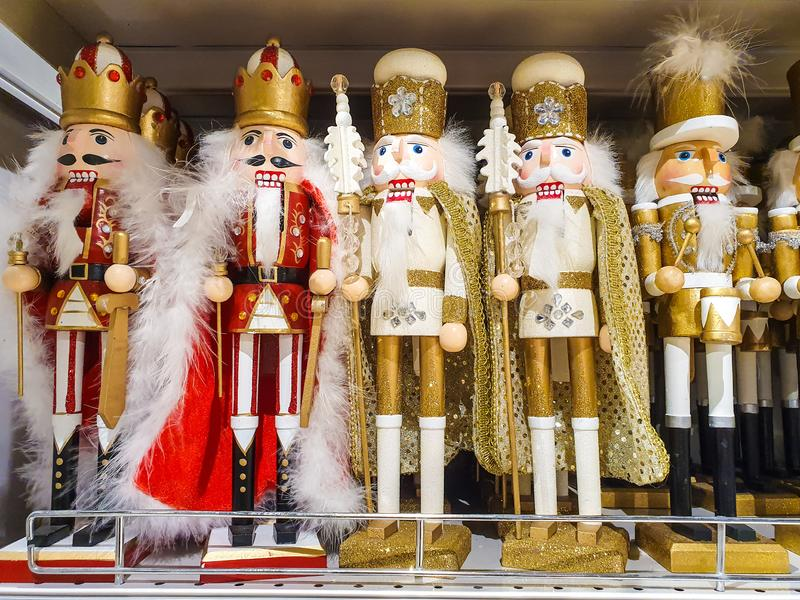 Several different nutcraker soldiers toys displayed in a store, christmas decoration for sale in market Happy New Year royalty free stock photo