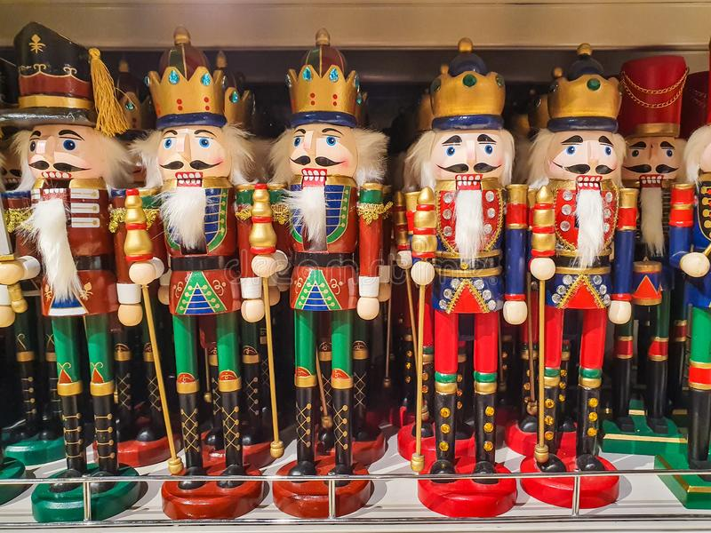 Several different nutcraker soldiers toys displayed in a store, christmas decoration for sale in market Happy New Year stock photo