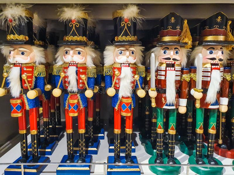 Several different nutcraker soldiers toys displayed in a store, christmas decoration for sale in market Happy New Year royalty free stock image