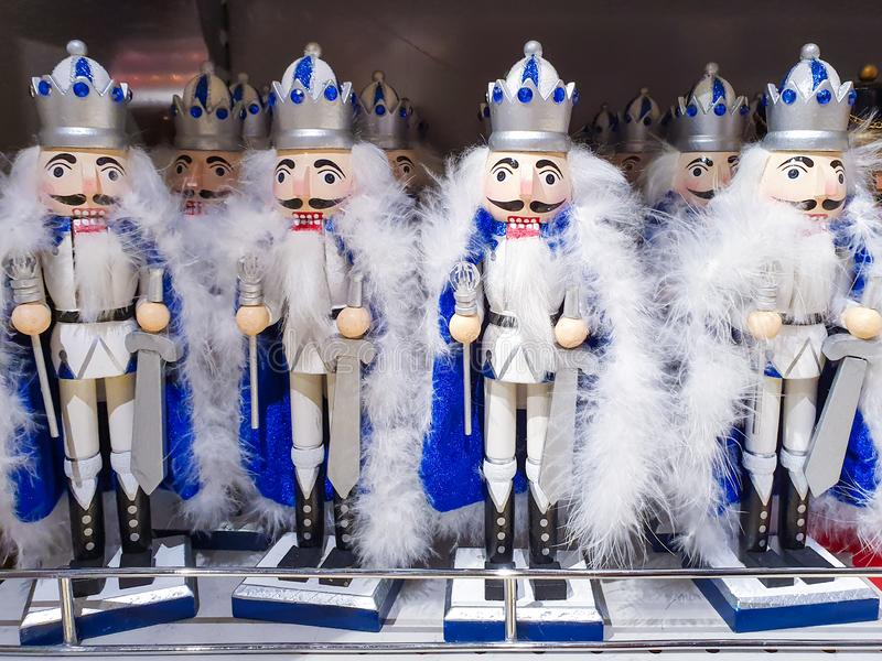 Several different nutcraker soldiers toys displayed in a store, christmas decoration for sale in market Happy New Year royalty free stock photography