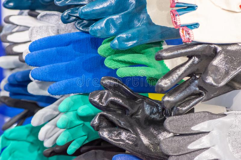 Several different textile rubber gloves for workers for protection and safety royalty free stock photography