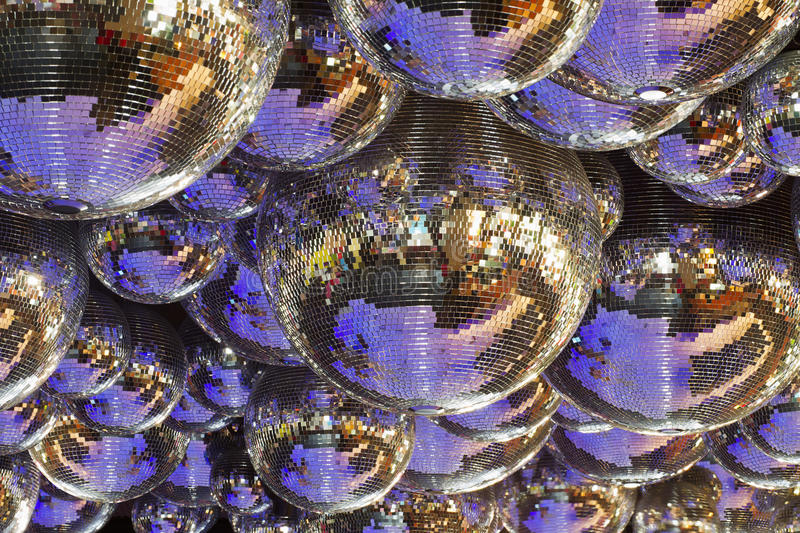 Several disco balls. Background of several disco balls royalty free stock images