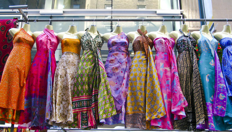 Several dresses hanging up at a market royalty free stock photography