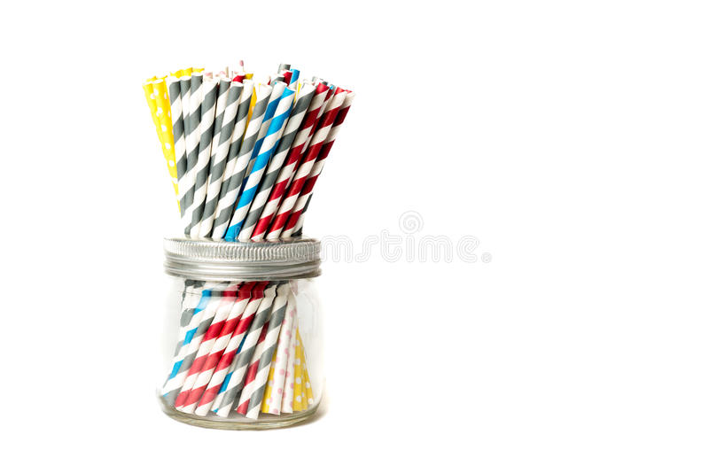 Several drinking straws in a jar royalty free stock photos