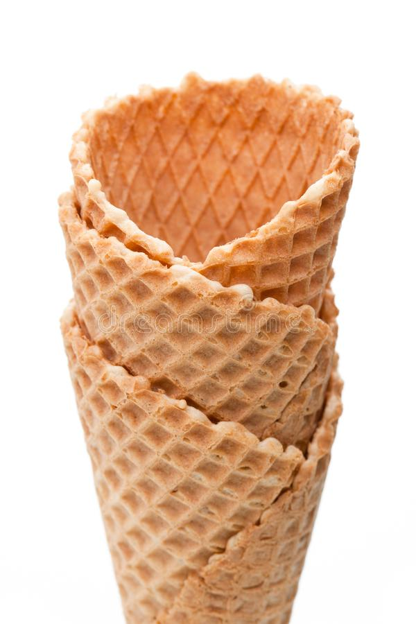 Several empty ice cream cones isolated on white background stock photography