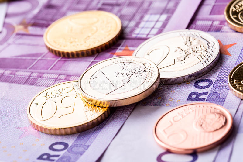Several 500 euro banknotes and coins are adjacent. Symbolic photo for wealth. Money concept royalty free stock photography