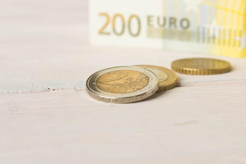 Several Euro coins on the background of Euro banknotes. The concept of savings royalty free stock images